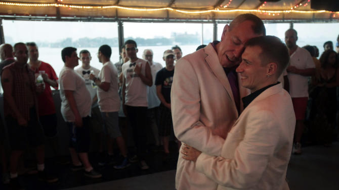 David Hind, left, and Craig Francisco dance their first dance after getting married on a cruise hosted by Marriage Equality New York in New York, Sunday, July 24, 2011. New York became the sixth and largest state to recognize same-sex weddings in a close state Senate vote on June 24 after strong lobbying by Cuomo and advocates. The first gay marriages in New York were performed just after midnight and continued through the day at municipal offices that opened for special weekend hours. (AP Photo/Seth Wenig)