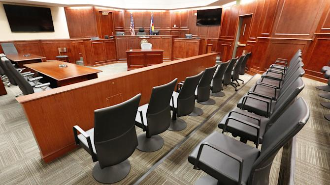 FILE - This Jan. 15, 2015, file photo shows the jury box, right, inside Courtroom 201, where the trial of Aurora movie theater shooting defendant James Holmes is currently taking place at Arapahoe County District Court in Centennial, Colo. Defense attorneys have urged jurors not to let emotions sway them, but with weeks of harrowing testimony still to come, experts say James Holmes' lawyers will have a difficult time convincing jurors to put sympathy behind them as they decide whether he was legally insane when he killed 12 people and injured 70 others in July 2012. (AP Photo/Brennan Linsley, Pool, File)