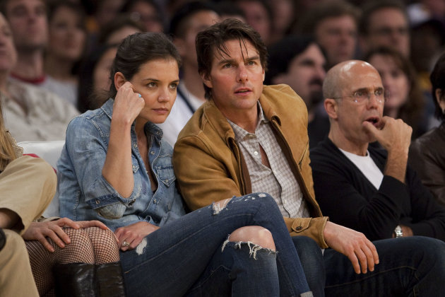 FILE - In this Friday, March 19, 2010 file photo, Katie Holmes and Tom Cruise watch the Minnesota Timberwolves play the Los Angeles Lakers in an NBA basketball game, in Los Angeles. The Lakers won 104