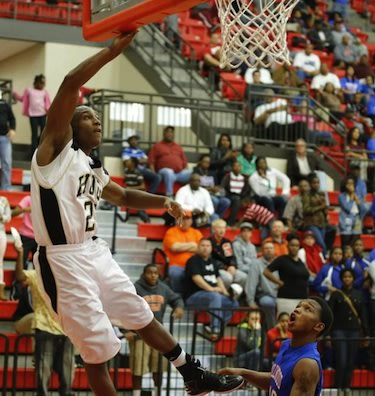 Trey Johnson scores the game-winning basket for Milwood on his own hoop — Bryan Terry/The Oklahoman
