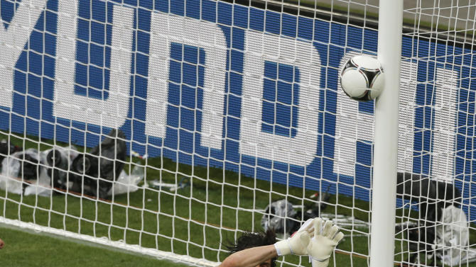 Croatia's Mario Mandzukic, left, scores his side's first goal past Italy goalkeeper Gianluigi Buffon during the Euro 2012 soccer championship Group C match between Italy and Croatia in Poznan, Poland, Thursday, June 14, 2012. (AP Photo/Anja Niedringhaus)