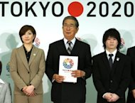 (L-R) Badminton player Reiko Shiota, Tokyo Governor Shintaro Ishihara and artistic gymnast Kohei Uchimura with the Tokyo 2020 floral Olympic bid logo in Tokyo in February. Hosting the 2020 Olympics is seen as an opportunity to help rebuild Japan and bring some much-needed joy to its people