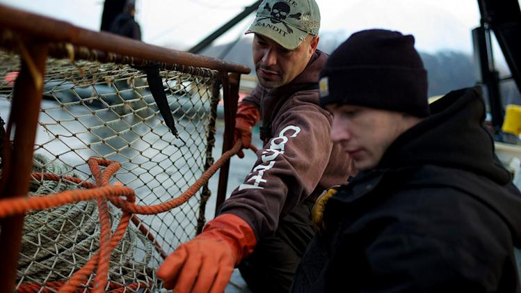 "Time Bandit Deckhands father and son Eddie Uwekoolani and Eddie Uwekoolani Jr. work to prepare the Time Bandit for fishing as seen on ""Deadliest Catch."""