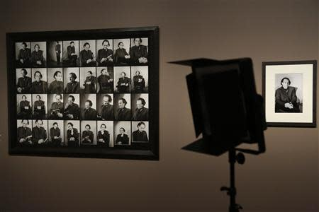 "A camera light is seen in the room where contact sheets of French playwright Antonin Artaud taken in 1947 are displayed on the wall during the exhibition, ""Van Gogh/Artaud The Man Suicided by Society"", in Paris"