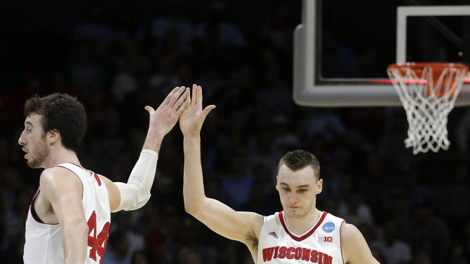 Wisconsin forward Sam Dekker (15) and forward Frank Kaminsky react at the end of the first half of a college basketball regional semifinal against North Carolina in the NCAA Tournament, Thursday, March 26, 2015, in Los Angeles. (AP Photo/Jae C. Hong)