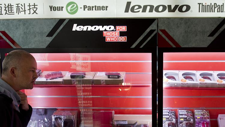 A man walks past advertising for Chinese technology giant Lenovo in Hong Kong on February 4, 2014