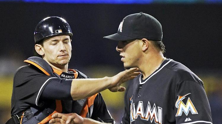 Miami Marlins catcher Rob Brantly congratulates pitcher Jose Fernandez after retiring the side against the Los Angeles Dodgers in the fifth inning of a baseball game in Los Angeles Friday, May 10, 2013. (AP Photo/Reed Saxon)