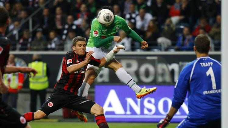 Eintracht Frankfurt's Sebastian Jung challenges Manuel Schmiedebach of Hanover 96 during their German first division Bundesliga soccer match in Frankfurt