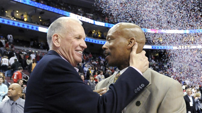 Philadelphia 76ers head coach Doug Collins, left, talks to Cleveland Cavaliers head coach Byron Scott at the end of an NBA basketball game, Sunday, April 14, 2013, in Philadelphia. The 76ers won their home finale 91-77. (AP Photo/Michael Perez)