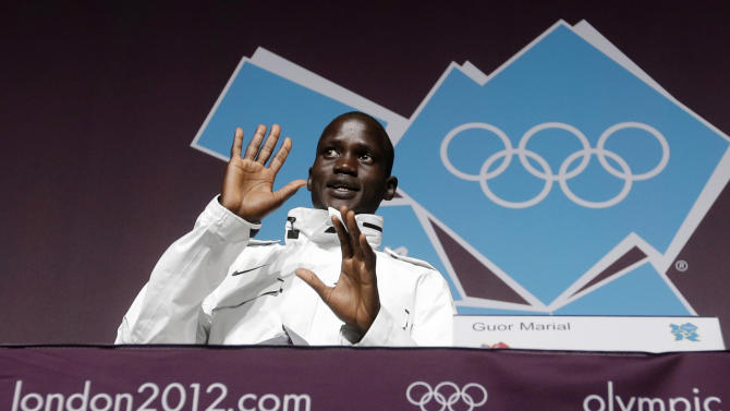 In this Friday, Aug. 10, 2012 photo, marathon runner Guor Marial, who is stateless, appears during a news conference at the 2012 Summer Olympics, in London. Marial, from South Sudan, will compete in the marathon under the Olympic flag. (AP Photo/Darron Cummings)