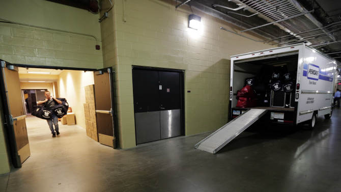 Bryan Heyza loads the New York Yankees bags into a vehicle after the team lost Game 4 of the American League championship series against the Detroit Tigers Thursday, Oct. 18, 2012, in Detroit. The Tigers, who won 8-1, move on to the World Series. (AP Photo/Charlie Riedel)