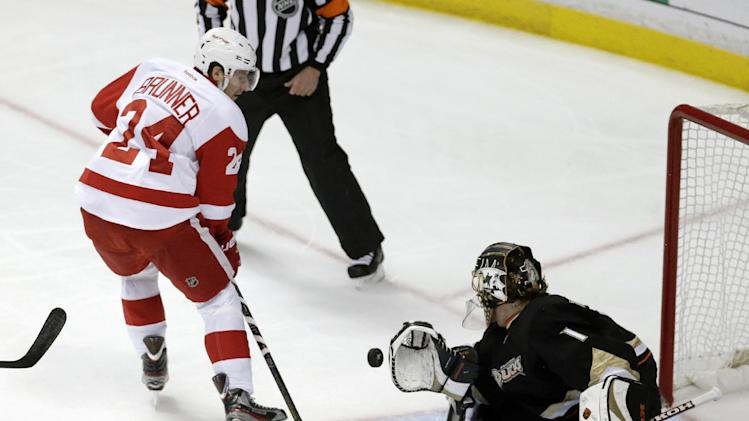 Anaheim Ducks goalie Jonas Hillert, right, blocks a shot by Detroit Red Wings center Damien Brunner during the second period in Game 5 of their first-round NHL hockey Stanley Cup playoff series in Anaheim, Calif., Wednesday, May 8, 2013. (AP Photo/Chris Carlson)