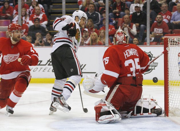 Blackhawks' Kruger watches as the puck goes behind Red Wings goalie Howard and off the post during Game 4 of their NHL Western Conference semifinals hockey playoff game in Detroit