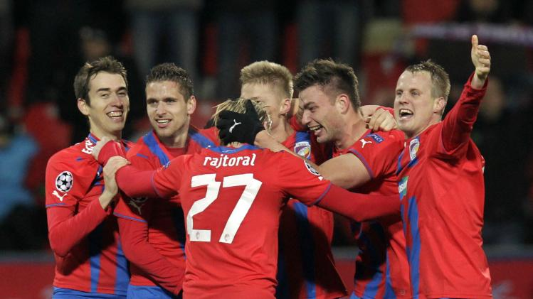 Viktoria Plzen's players celebrate after winning their Champions League soccer match against CSKA Moscow in Plzen