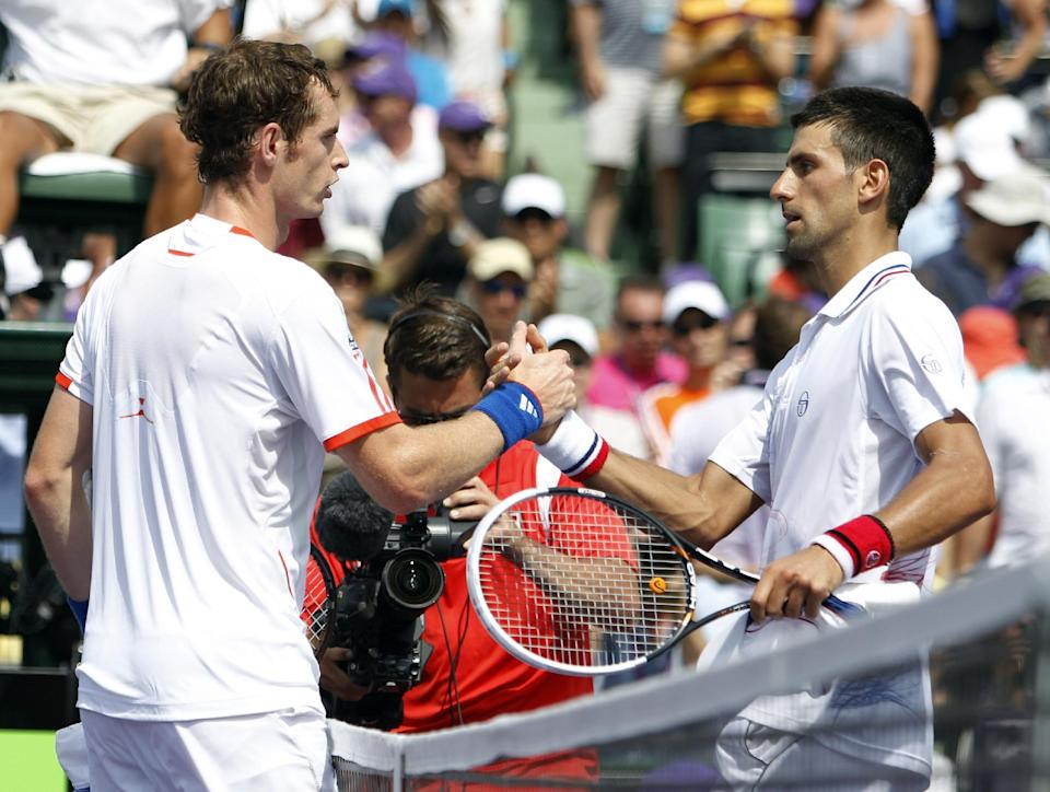 Novak Djokovic, right, of Serbia, and Andy Murray, of Great Britain, shake hands after Djokovic defeated Murray 6-1, 7-6(4) during the men's singles final match at the Sony Ericsson Open tennis tournament on Sunday, April 1, 2012, in Key Biscayne, Fla. (AP Photo/Lynne Sladky)