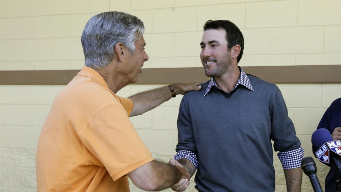 Detroit Tigers pitcher Justin Verlander, right, shakes hands with team president, CEO and general manager Dave Dombrowski during a news conference after a spring baseball exhibition game on Friday, March 29, 2013, in Lakeland, Fla., where Verlander talked about his new seven-year, $180-million contract. (AP Photo/Carlos Osorio)