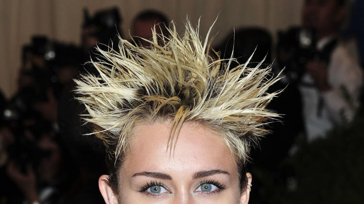 "Miley Cyrus attends The Metropolitan Museum of Art's Costume Institute benefit celebrating ""PUNK: Chaos to Couture"" on Monday May 6, 2013 in New York. (Photo by Charles Sykes/Invision/AP)"