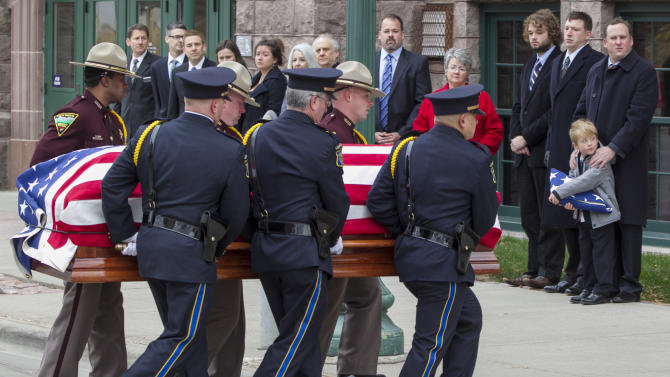 Family members including great-grandson Will Mead, bottom right, watch as the casket of former Democratic U.S. Senator and three-time presidential candidate George McGovern, is carried into the Washington Pavilion of Arts and Science in Sioux Falls, S.D., for the funeral service, Friday, Oct. 26, 2012. McGovern died Sunday in his native South Dakota at age 90. (AP Photo/Nati Harnik)
