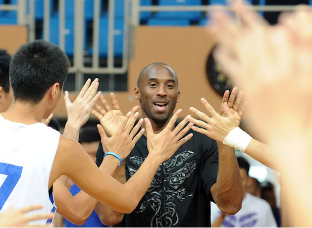 US NBA star Kobe Bryant meets a group of