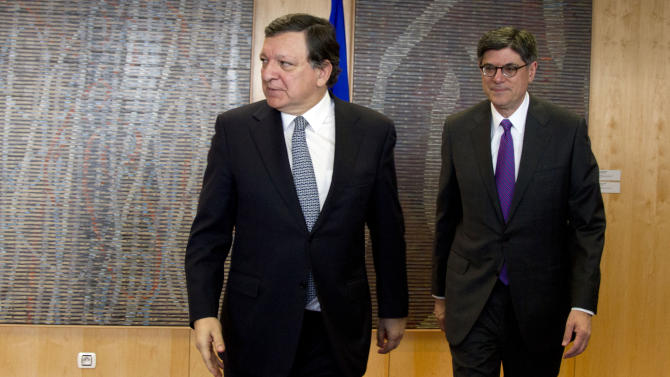 U.S. Treasury Secretary Jacob Lew, right, and European Commission President Jose Manuel Barroso meet at EU headquarters in Brussels on Monday, April 8, 2013. U.S. Treasury Secretary Jacob Lew is starting a series of meetings with key European Union leaders during his first official visit to the region. Lew is expected to urge the European officials to promote more growth-friendly policies to counter the debt crisis that has for three years engulfed the 27-nation bloc, which together forms the world's largest economy. (AP Photo/Virginia Mayo)