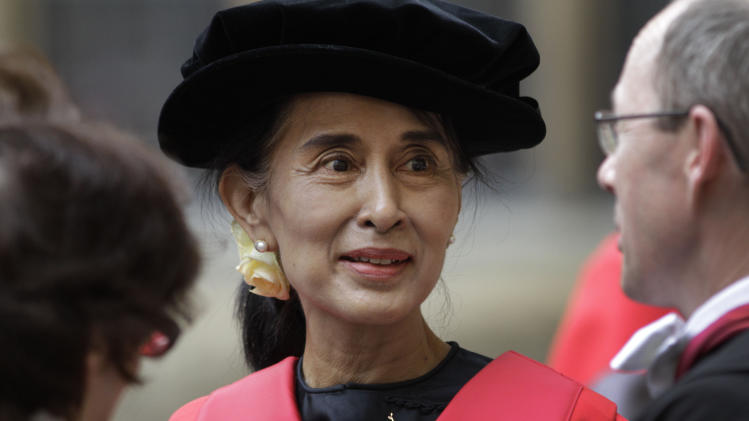 FILE - In this Wednesday, June 20, 2012 file photo, Myanmar opposition leader Aung San Suu Kyi talks to people  following an award ceremony at the Oxford University, Oxford, England. Back amid Oxford's Gothic spires, Suu Kyi recalled taking boat rides with friends along the River Cherwell and daydreaming in the library instead of studying. The most important thing she learned, she said, was a respect for all of civilization. (AP Photo/Lefteris Pitarakis, File)