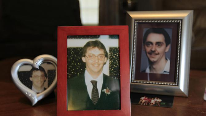 This Oct. 17, 2012 photo shows framed pictures of James Cotaling, who was murdered in 1990, at the home of his younger sister, Jody Robinson, in Davisburg, Mich. Robinson is very outspoken against reconsidering the sentences of juvenile offenders serving life without parole. Her views are shaped by her family's own heartbreak and anger at the loss of Cotaling. One of the two people convicted in his murder was 16 at the time. (AP Photo/Carlos Osorio)