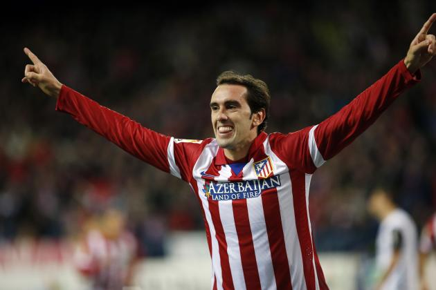 Atletico Madrid's Diego Godin celebrates his goal during their Spanish King's Cup soccer match against Valencia at the Vicente Calderon stadium in Madrid