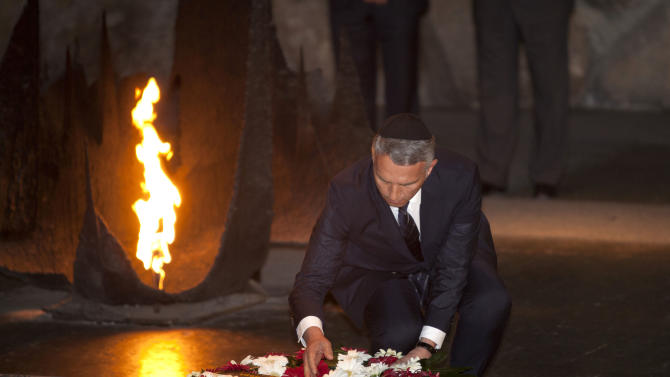 Swiss Foreign Minister Didier Burkhalter lays a wreath at the Hall of Remembrance at the Yad Vashem Holocaust memorial, in Jerusalem, Thursday, May 2, 2013. Burkhalter is on an official visit to the region. (AP Photo/Sebastian Scheiner)