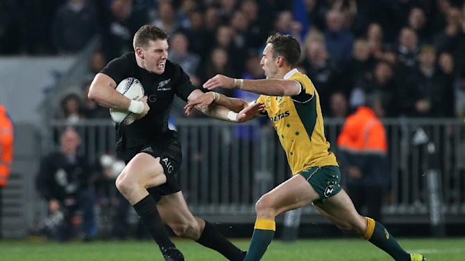 All Black Colin Slade (L) is tackled by Australia's Nic White during the Bledisloe Cup rugby union match in Auckland on August 15, 2015