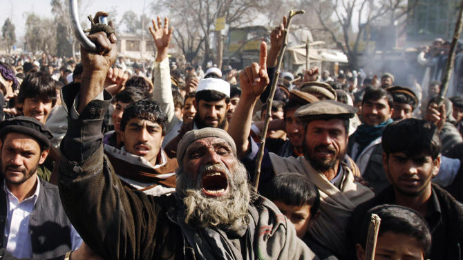 Afghans shout anti-US slogans during a demonstration in Mehterlam, Laghman province east of Kabul, Afghanistan, Thursday, Feb. 23, 2012. Afghan police on Thursday fired shots in the air to disperse hundreds of protesters who tried to break into an American military base in the country's east to vent their anger over this week's Quran burnings incident. (AP Photo/Rahmat Gul)