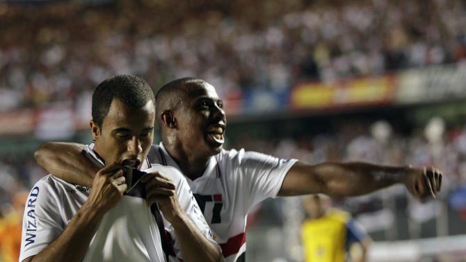 Brazil's Sao Paulo FC's Lucas, left, celebrates with teammate Wellington after scoring against Argentina's Tigre during the Copa Sudamericana final soccer match in Sao Paulo, Brazil, Wednesday, Dec. 12, 2012. (AP Photo/Andre Penner)