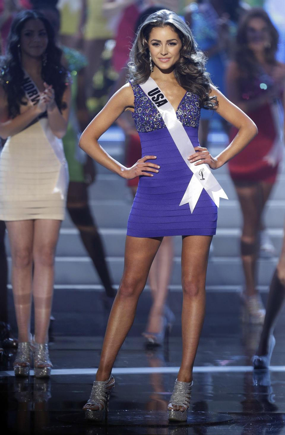 Miss USA Olivia Culpo steps out as she is named one of the final 16 contestants during the Miss Universe pageant, Wednesday, Dec. 19, 2012, in Las Vegas. (AP Photo/Julie Jacobson)