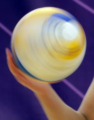 April Ross of the United States spins the ball during a beach volleyball match against Spain at the 2012 Summer Olympics, Thursday, Aug. 2, 2012, in London. (AP Photo/Dave Martin)