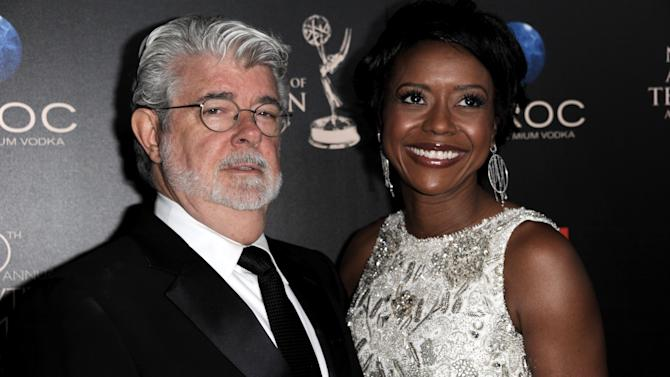 "FILE - In this June 16, 2013 file photo, George Lucas, left, and longtime girlfriend Mellody Hobson arrive at the 40th Annual Daytime Emmy Awards in Beverly Hills, Calif. A Lucasfilm spokeswoman on Monday, June 24, 2013 confirmed the ""Star Wars"" creator married Hobson in a weekend ceremony at Skywalker Ranch north of San Francisco. (Photo by Richard Shotwell/Invision/AP, File)"