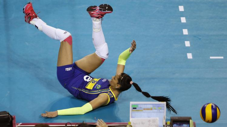 Carvalho of Brazil falls after trying to receive the ball during their FIVB Women's Volleyball World Grand Prix 2014 final round match against China in Tokyo