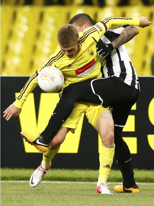 Anzhi Makhachkala's Shatov fights for the ball with Newcastle United's Simpson during their Europa League soccer match at the Luzhniki stadium in Moscow