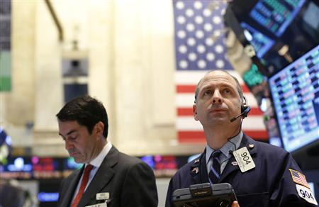 Traders work on the floor at the New York Stock Exchange, March 19, 2013. REUTERS/Brendan McDermid