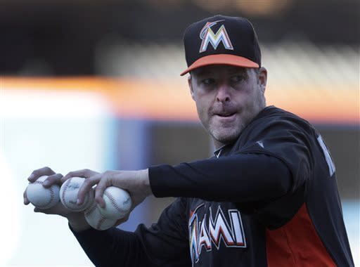 Marlins get manager Mike Redmond his first win