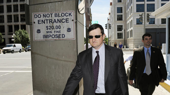 Government prosecutor Steve Durham walks from federal court in Washington, Thursday, July 14, 2011,  after a mistrial was declared in the government's case against former Major League Baseball pitcher Roger Clemens. (AP Photo/Cliff Owen)