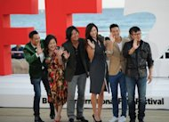 "Stars of ""The Thieves"" -- (L-R) Simon Yam, Kim Hae-Sook, Kim Yoon-Seok, Jeon Ji-Hyun and Derek Tsang -- with director Choi Dong-Hun (R) in Busan in October. South Korea's film industry has capped a spectacular year with the number of tickets sold for domestic movies breaking through the 100 million mark for the first time, an official said Wednesday"
