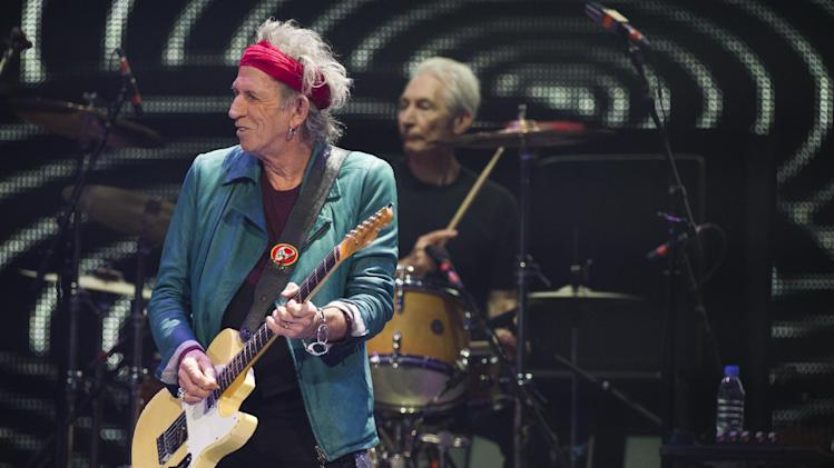 Keith Richards, left, and Charlie Watts of The Rolling Stones perform in concert on Saturday, Dec. 8, 2012 in New York. (Photo by Charles Sykes/Invision/AP)