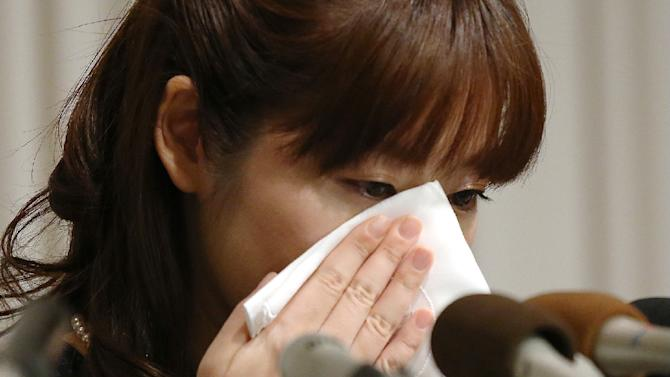 Haruko Obokata, 31, a researcher at Japan's Riken institute, wipes away tears during a press conference in Osaka, western Japan, on April 9, 2014