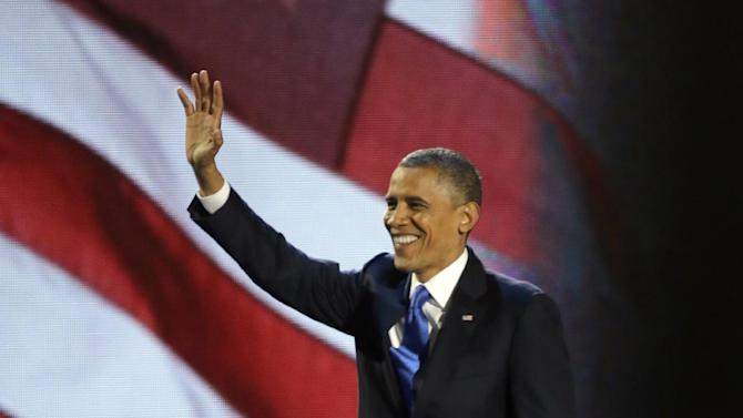 President Barack Obama waves to his supporters after his speech at his election night party Wednesday, Nov. 7, 2012, in Chicago. President Obama defeated Republican challenger former Massachusetts Gov. Mitt Romney. (AP Photo/Pablo Martinez Monsivais)