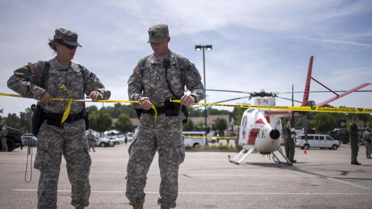 National Guard troops cordon off a staging area inside a shopping center parking lot in Ferguson, Missouri
