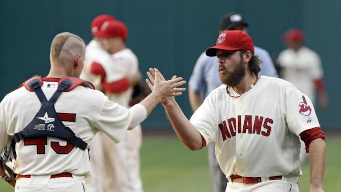 Cleveland Indians relief pitcher Chris Perez, right, and catcher Luke Carlin celebrate their 8-5 win over the Kansas City Royals in a baseball game, Monday, May 28, 2012, in Cleveland. (AP Photo/Mark Duncan)