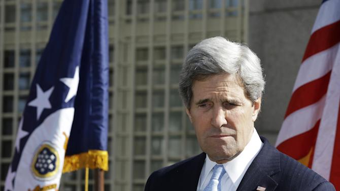 U.S. Secretary of State John Kerry pauses while speaking about the death of Mustafa Akarsu, a U.S. Embassy guard who was killed on Kerry's first day as secretary by a suicide bomber attack at the U.S. Embassy in Ankara, Turkey, during a memorial at the embassy on Friday, March 1, 2013. Ankara is the fifth leg of Kerry's first official overseas trip, a nine-day dash through Europe and the Middle East. (AP Photo/Jacquelyn Martin, Pool)