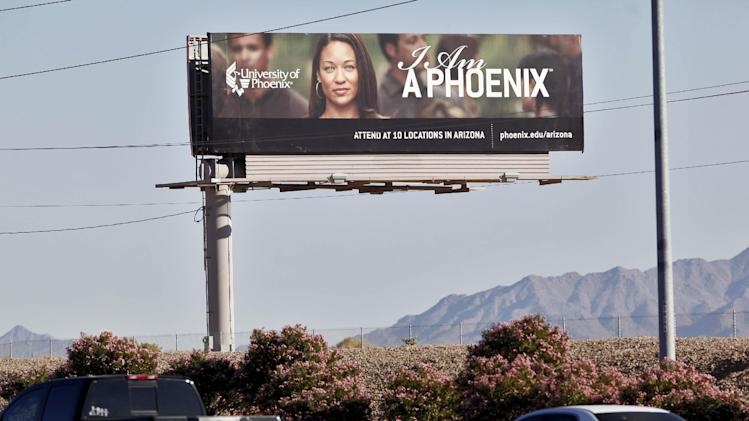 FILE - In this Nov 24, 2009 file photo, a University of Phoenix billboard is shown in Chandler, Ariz.  Two senators say for-profit colleges are using too much taxpayer money to recruit students. Sen. Tom Harkin, D-Iowa, and Sn. Kay Hagan, D-N.C., introduced a bill Wednesday to prohibit colleges of all kinds from using dollars from federal student assistance programs to pay for advertising. (AP Photo/Matt York, File)