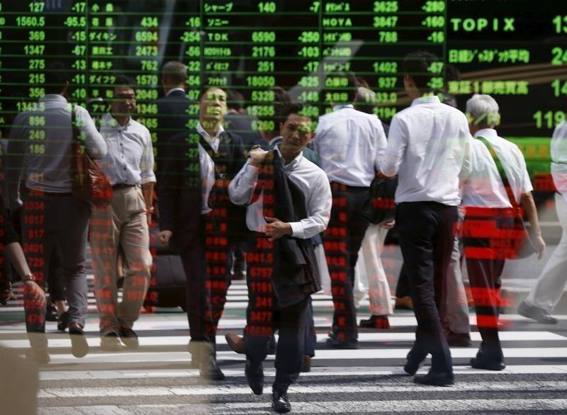 Global stocks up, oil slides as concerns ease over Russia-Turkey tension