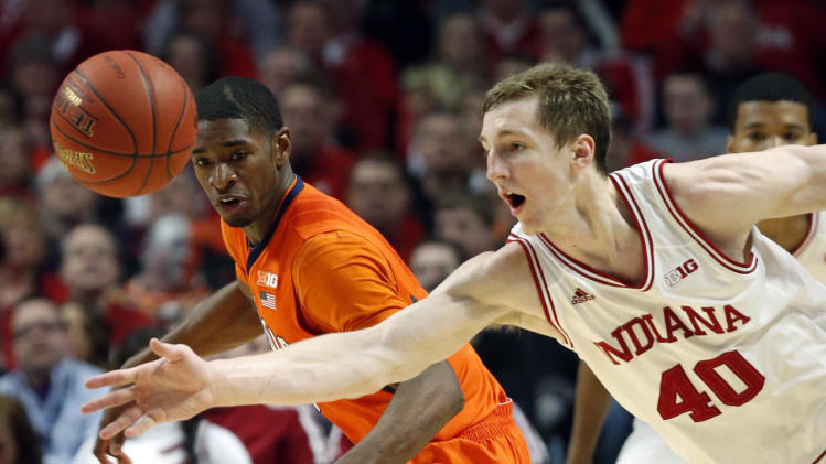 Illinois' Brandon Paul and Indiana's Cody Zeller (40) go after a loose ball during the first half of an NCAA college basketball game at the Big Ten tournament Friday, March 15, 2013, in Chicago. (AP Photo/Charles Rex Arbogast)