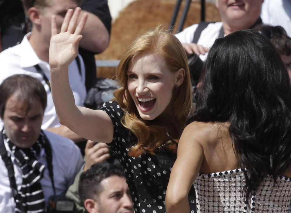 Actress Jessica Chastain waves during a photo call for Madagascar 3 during the 65th international film festival, in Cannes, southern France, Thursday, May 17, 2012. (AP Photo/Lionel Cironneau)